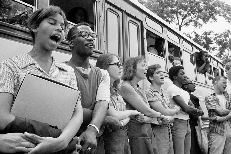 A photo from 60's displaying multiethnic group singing